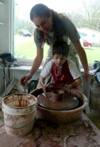 Elijah making a pot on the wheel