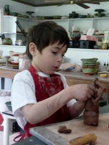 Elijah making a sculpture