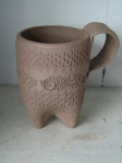 Not glazed, but beautiful!  Handmade mug