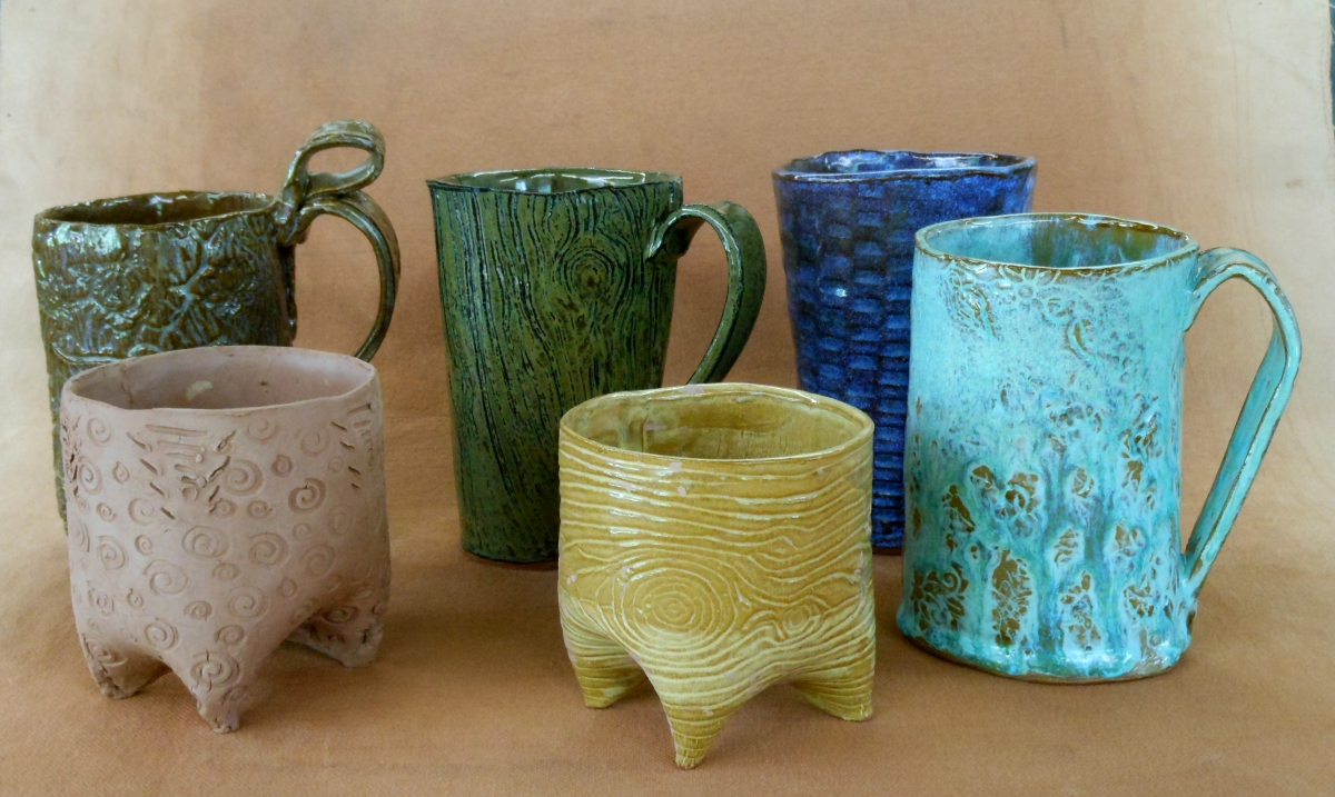 Cups and Mugs by students at Pincu Pottery